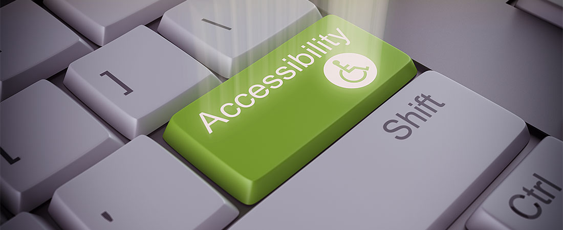 Computer keyboard with green accessiblity return key with with wheelchair icon