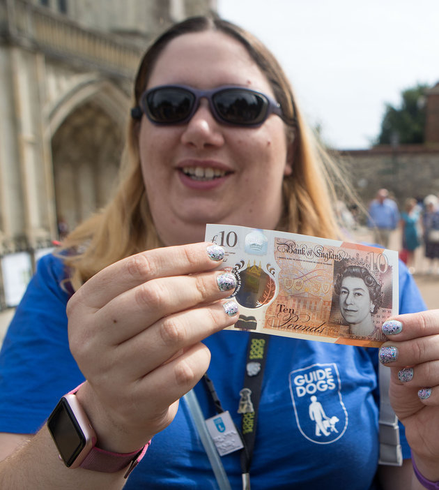 Jemma Brown, from Guide Dogs, tests the feature on the new £10 note