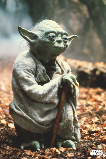 Yoda leaning on hist walking stick